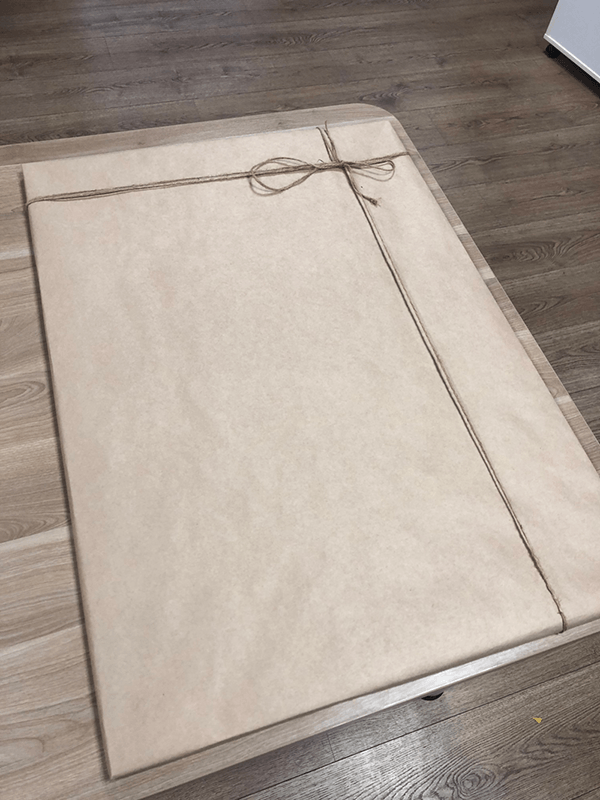 mapstar.space - wrapping a star card in kraft paper